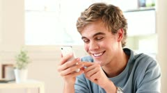 Happy man sending text message on cell phone mobile Stock Footage