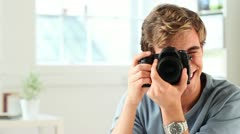 Happy man taking photograph - stock footage