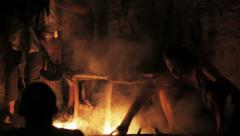 Workers melting steel on the bonfire Stock Footage