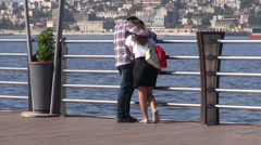 Young couple in love on Baku promenade, Azerbaijan Stock Footage