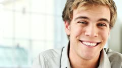Gorgeous young man laughing Stock Footage