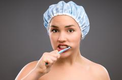 Woman brushing teeth Stock Photos