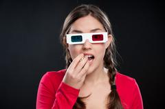 Teenage girl watching 3d Movie - stock photo