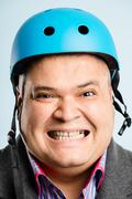 funny man wearing cycling helmet portrait real people high definition blue ba - stock photo