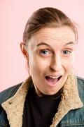 Funny woman portrait pink background real people high definition Stock Photos