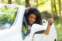 Young black teenage driver holding car keys driving her new car Stock Photos