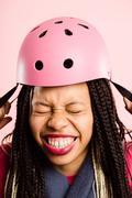 Funny woman wearing cycling helmet portrait pink background real people high  Stock Photos