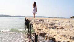 Stock Video Footage of Rusty Pier Woman Walking Beauty and Desolation Concept HD