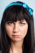 funny woman portrait real people high definition blue background - stock photo