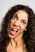 Funny woman portrait real people high definition grey background Stock Photos