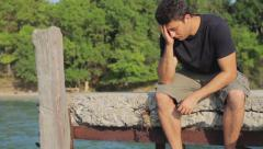 Man Sitting On Jetty Depression Concept Unhappy HD Stock Footage