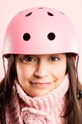 funny woman wearing cycling helmet portrait pink background real people high  - stock photo