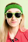 Funny woman portrait real people high definition green background Stock Photos