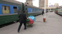 Train porter pushing luggage at Baku station, transport in Azerbaijan Stock Footage