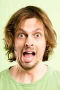 Stock Photo of funny man portrait real people high definition green background