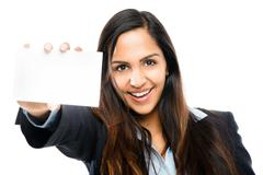 happy indian businesswoman holding white placard isolated - stock photo