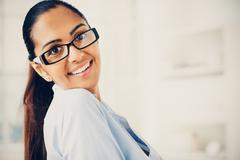 beautiful indian business woman portrait smiling happy - stock photo