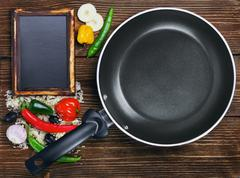 rice with vegetables next to a frying pan - stock photo