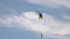 Astar helicopter water drop, slow motion Stock Footage
