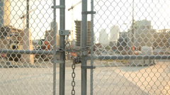 Locked gate at worksite. - stock footage