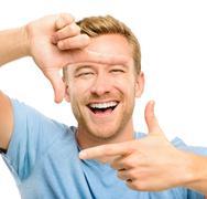 happy man framing photograph - stock photo