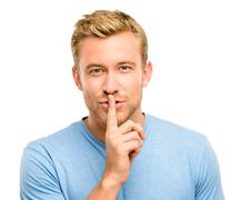 sexy man with finger on lips - stock photo