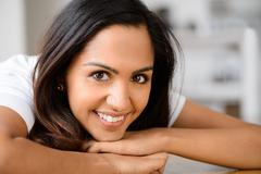 Closeup portrait of cute indian teenage girl smiling at home Stock Photos