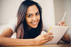 happy indian woman student education writing studying - stock photo