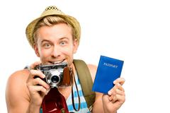 Happy young tourist man holding passport retro camera white background Stock Photos