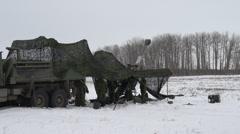 Military, artillery 155mm gun under tarp Stock Footage
