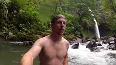 Unique clip of swimming at amazing waterfall spot Stock Footage