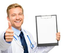 Portrait of confident young doctor on white background Stock Photos