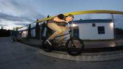 Amazing bmx backwards grinding trick Stock Footage
