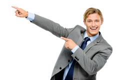 happy businessman pointing isolated on white background - stock photo