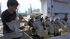 Connecting oil hose to cargo ship, industrial, crew, industry, Azerbaijan Stock Footage