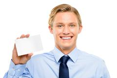 Confident young businessman holding placard isolated  on white background Stock Photos