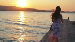 Female Model Running Toward Sunset Jetty Ocean Freedom Concept Stock Footage