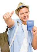 Happy tourist man holding passport isolated on white background Stock Photos