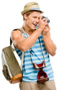 happy tourist man photographing vintage camera isolated on white background - stock photo
