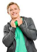 Handsome young man smiling isolated on white background Stock Photos
