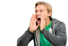 Happy young man shouting isolated on white background Stock Photos