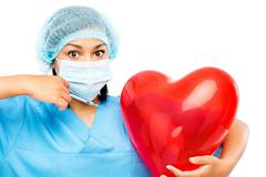 african american nurse holidng heart - stock photo