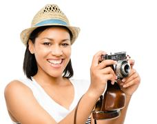 beautiful mixed race woman taking photograph vintage camera isolated on white - stock photo