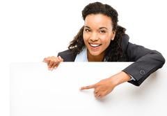 pretty african american businesswoman holding billboard isolated on white bac - stock photo