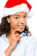 happy mixed race businesswoman wearing christmas hat isolated on white backgr - stock photo