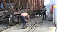 Stock Video Footage of Fastening chains of cargo trucks on board a vessel at the Caspian Sea