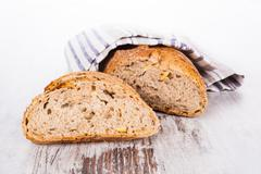 Bright bread still life, french country style. Stock Photos
