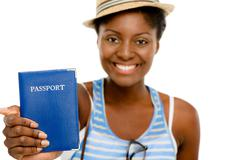 Happy african american woman tourist holding passport white background Stock Photos