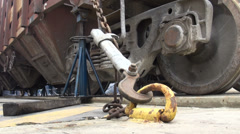 Wheels of a train are tied to the floor of a cargo vessel, on the Caspian Sea Stock Footage
