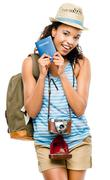 Happy african american woman tourist holding passport Stock Photos